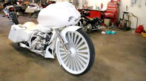 30 inch floater on white and chrome harley davidson motorcycle