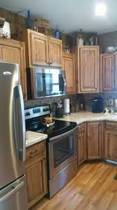 Rustic Knotty Alder with black glaze kitchen cabinets. Countertop is Spring  Carnival premium laminate.