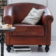 brown leather reading chair with rustic accent pillow and round side table most comfortable reading chair