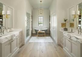 bathrooms with wood floors. Pale Gray Washstands Facing Each Other Across From Pine Wood Floors Bathrooms With O
