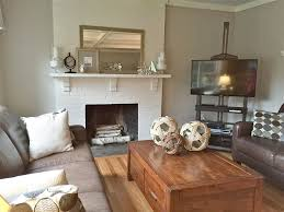 scenicote living room with painted brick fireplace hardwood floorsountry ideas uk decor furniture