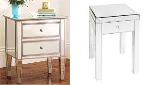 classsic mirror bed side table having two drawers and 4 short tapered legs placed on brown bed side furniture