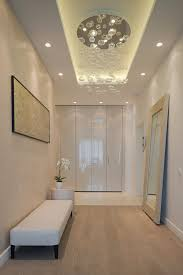 entrance lighting ideas. lighting details create drama in modern open plan apartment entrance ideas r