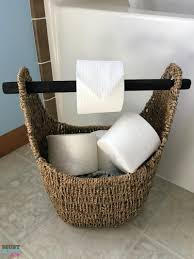 diy toilet paper holder idea use a wicker basket with a wood handle as a