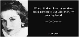 Image result for Coco Chanel wearing black and white