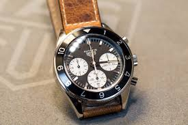autavia watch is a portmanteau combination of automotive and aviation released by jack heuer in 1962 for the first time and it is the first watch with a