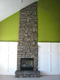 mortar for fireplace this on the left is applied on a style home with a yellow