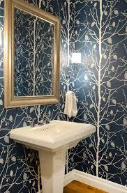 slim sconces like the savoy house monroe are a smart choice for powder room lighting