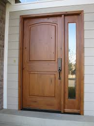 large single custom wood exterior doors with narrow glass panels and black metal handle ideas