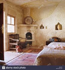 Open Stone Fireplace Turkish Bedroom With Stone Walls And Open Fireplace Stock Photo