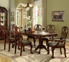 the brussels dining collection by crown mark introduces elaborate carvings and careful detailed moulding finished in rich cherry with burl inlays