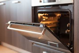 use a combination of water and dishwashing to clean the racks and let them air dry for a while once the racks are dry place them in the oven