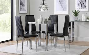 gallery solar round chrome and glass dining table with 4 leon black chairs