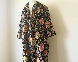 carpet jacket. vintage 1960s tapestry carpet jacket coat black floral mid length