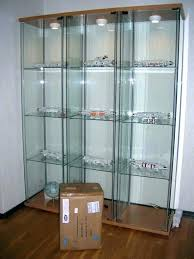 glass curio display cabinet with lights light all lighted lock ikea detolf