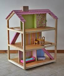 DIY: Dream Dollhouse by Ana White. Build a three story dream dollhouse  perfect for dolls with these free easy step by step do it yourself dollhouse  plans!