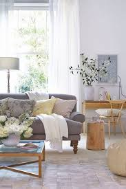 decorating with grey furniture. stunning neutral living room scheme with a grey sofa and wooden accessories for more decorating furniture g