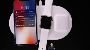 iphone x price. apple senior vice president of worldwide marketing, phil schiller, shows the iphone x during iphone price