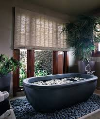 view in gallery beautiful basalt tub placed in a bed or river rocks