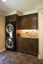 lighting for laundry room. under cabinet lighting ideas laundry room traditional with stackable washer and dryer crown molding for