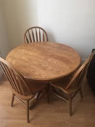 real wood round table with 3 chairs