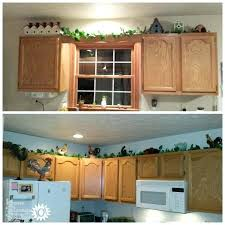 decorating tops of kitchen cabinets ideas for decorating above kitchen cabinets in your home on home
