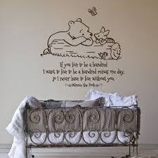 winnie the pooh words es for nursery wall decals design with antique cradles ideas