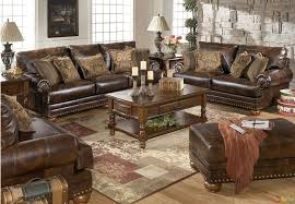 traditional brown bonded leather sofa loveseat living room set pillows nailheads ashley traditional