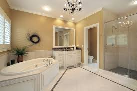 white ceramic tile bathroom with dark gray stone mosaic tiles and beautiful glass chandelier