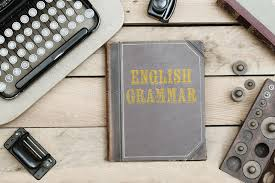 english grammar on old book cover at office desk with vine it stock photo