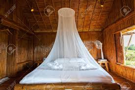 Rural style bedroom with canopy bed , bamboo decorated. Very..