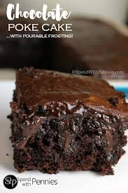 a serving of chocolate poke cake from scratch on a white plate