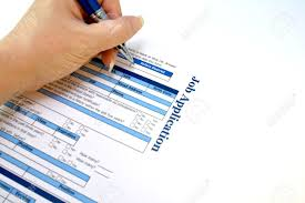 female hand filling out a job application stock photo picture and female hand filling out a job application stock photo 15587256