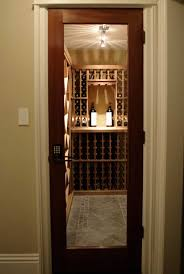 a vint custom mahogany full glass square fully insulated smalle wine room entrance door