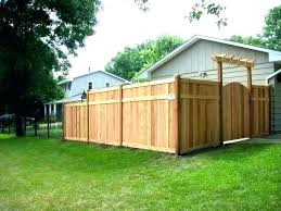 building a wood fence on uneven ground build privacy backyard how to concrete building a wood fence
