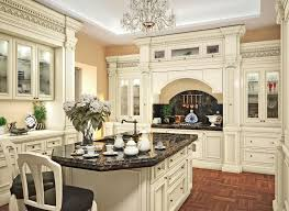 white ornate cabinet and black granite countertop with ont parquet flooring pattern for classic kitchen design