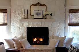 painting a fireplace whitePainted Stone Fireplace  Most Lovely Things
