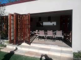 wooden sliding doors and aluminium stack doors repair