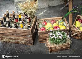 wine bottles apples pears flowers decorative wooden boxes stock photo