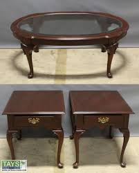 two ethan allen end tables and one glass top coffee table