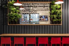 design detail the walls of this burger bar are covered in black corrugated steel