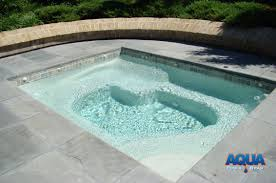 we can contour the interior of the hot tub to approach that of a portable spa