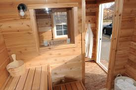 a lively open hot room sauna door candle window and all cedar tongue and