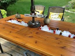 outdoor cedar table with built in coolers for beer and wine