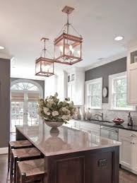 kitchen island light fixtures green strawberry motif napkin silver stainless steel chimney countertop white round glass bowl varnished wooden cabinet