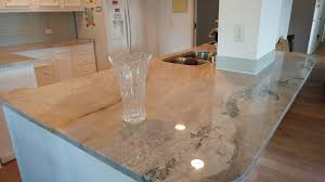 light color quartz countertops kitchen island and countertop with white cabinets corner view