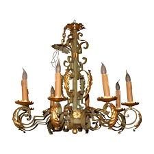 wrought iron chandelier green gray and gold with 8 lights in the taste of gilbert poillerat with decoration in acanthus leaf