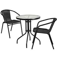 23 75 round glass metal table with 2 black rattan stack chairs