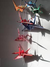 Japanese Origami Cranes Hanging In Bedroom Stocksy United