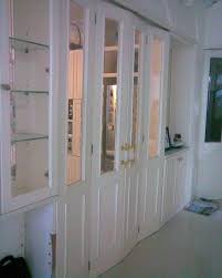 classical white painted wooden closet doors with half mirror with closet doors for bedrooms plus interior